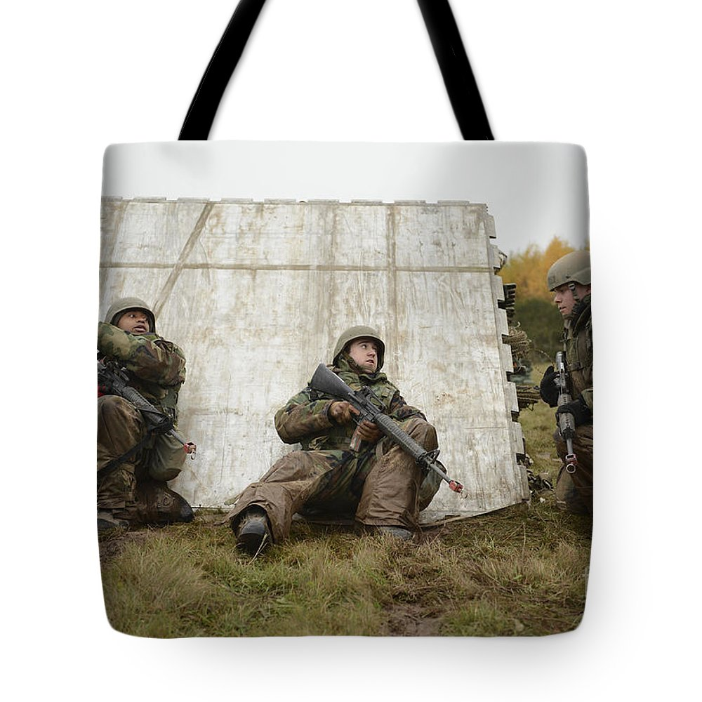 Spangdahlem Air Base Tote Bag featuring the photograph Airmen Try To Pinpoint The Source by Stocktrek Images