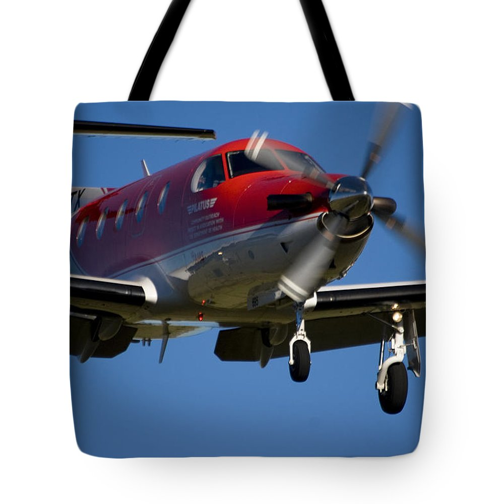 Pilatus Pc 12 Tote Bag featuring the photograph Almost There by Paul Job