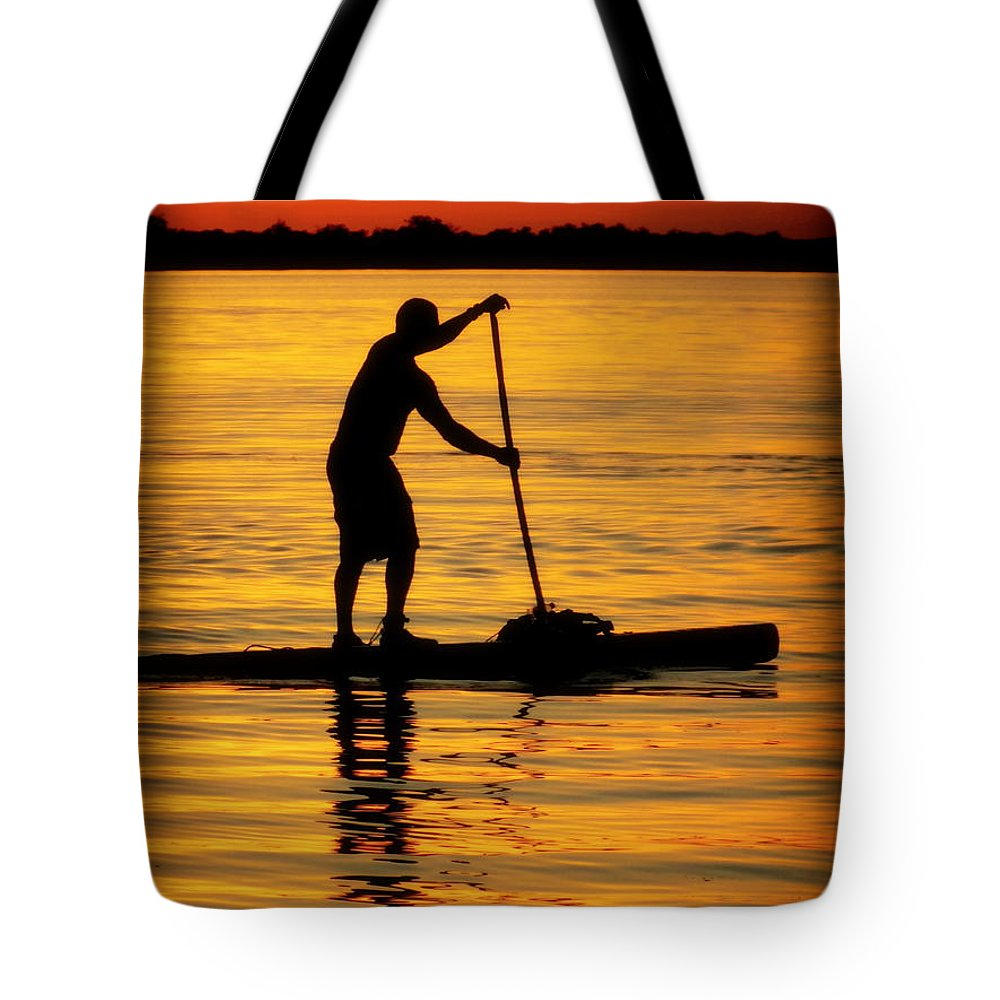 Paddle Boarding Tote Bag featuring the photograph Alone With The Sun by Karen Wiles