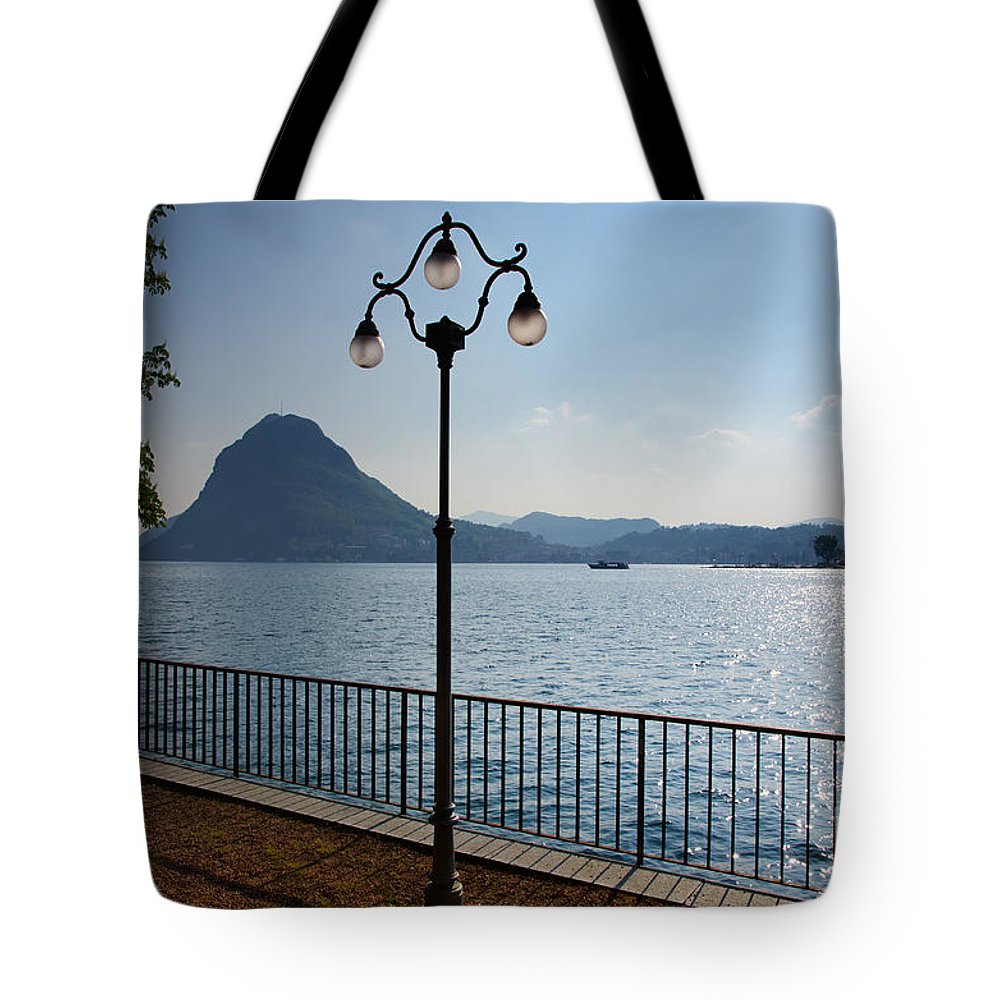 Lake Tote Bag featuring the photograph Alpine Lake With Street Lamp by Mats Silvan