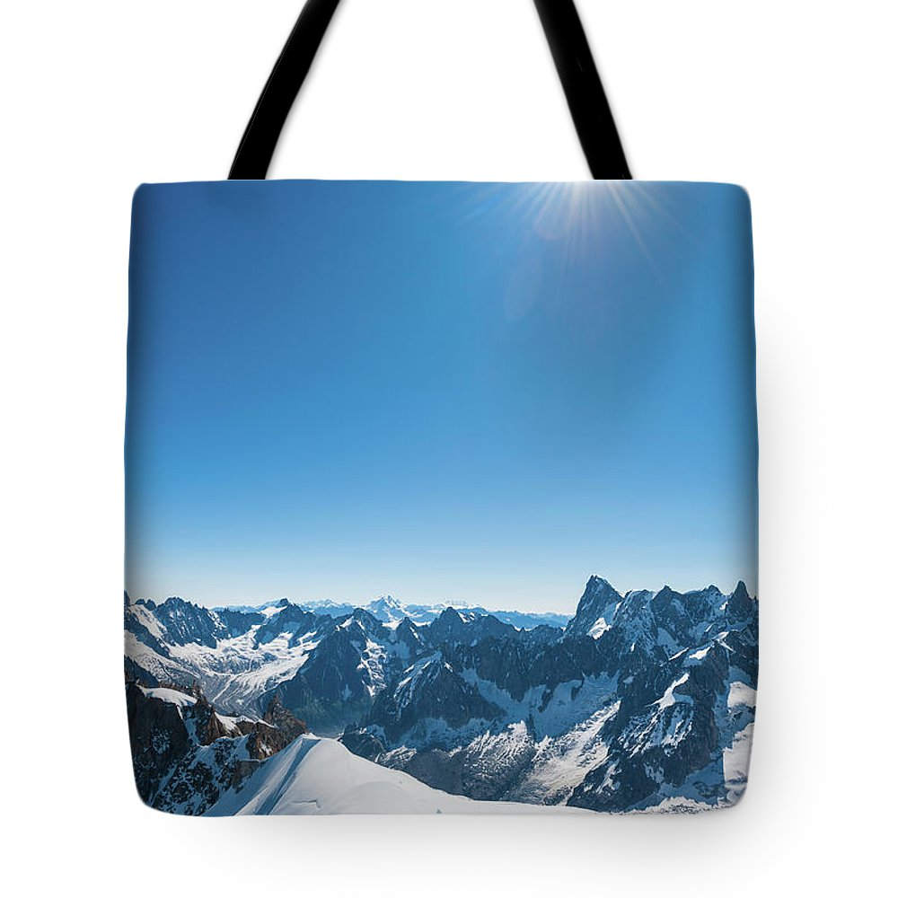Scenics Tote Bag featuring the photograph Alps Snow Summit Sunburst Mountaineers by Fotovoyager