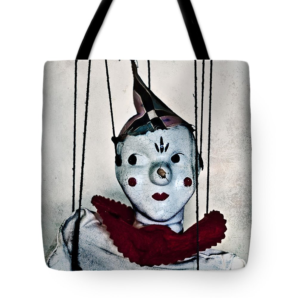 Marionette; Toy; Clown; Strings; Scary; Spooky; Looking Away; Old; Vintage; Broken; Cracked; Evil; Play; Puppet; Hands; Horror; Hat; Painted Face; Face; Paint; Red; Collar; Antique; Dirty; Creepy; Doll Tote Bag featuring the photograph Always Wondering by Margie Hurwich
