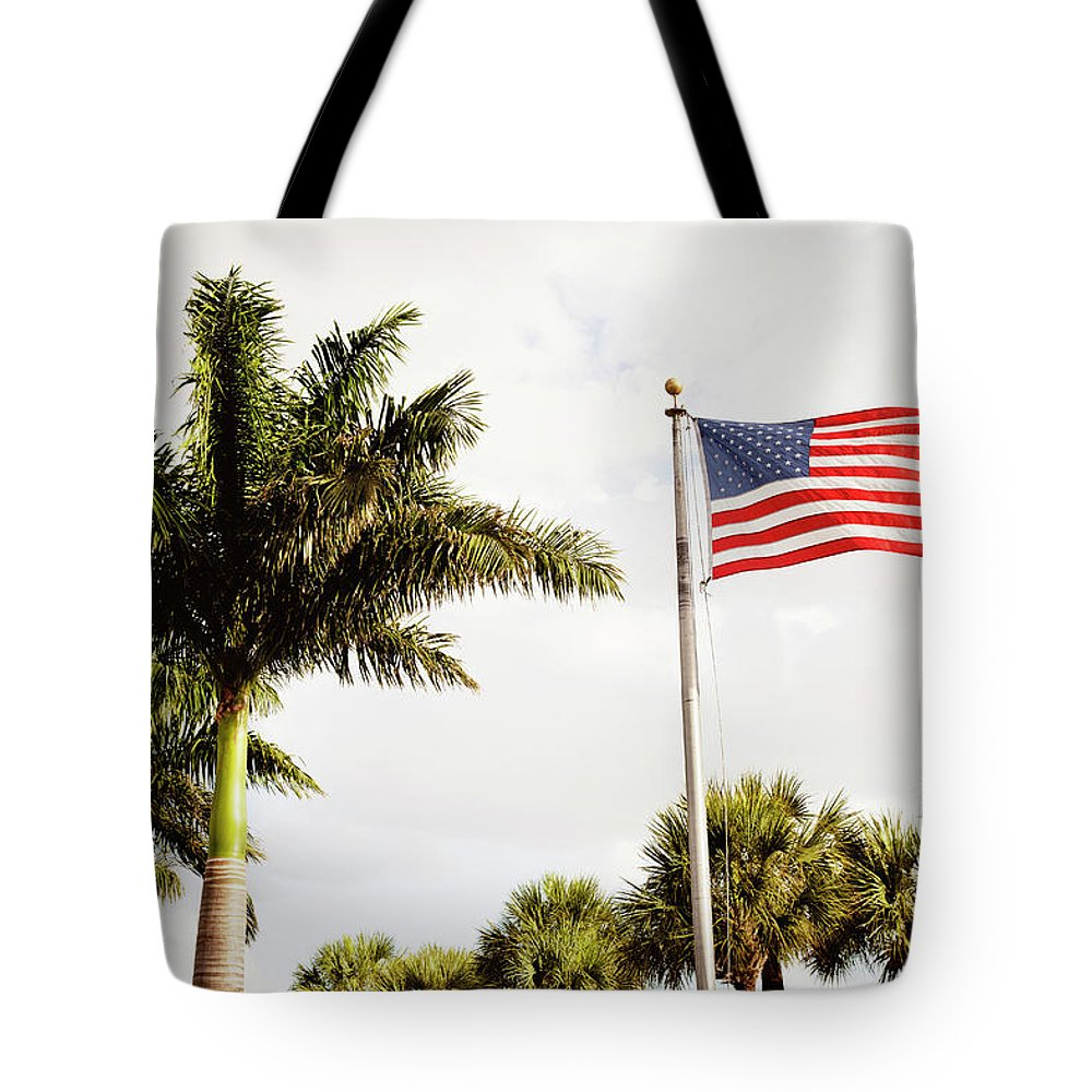 Tranquility Tote Bag featuring the photograph American Flag Flying Amongst Palm Trees by Ron Levine