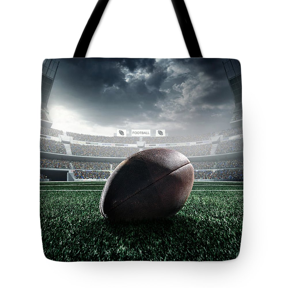 Event Tote Bag featuring the photograph American Football Ball by Dmytro Aksonov