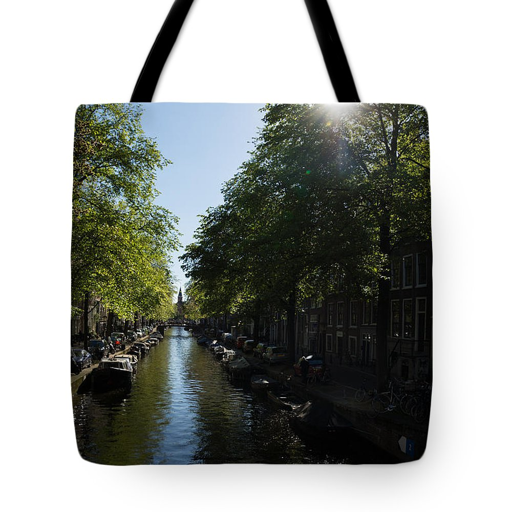 Amsterdam Tote Bag featuring the photograph Amsterdam Spring - Green Sunny And Beautiful by Georgia Mizuleva