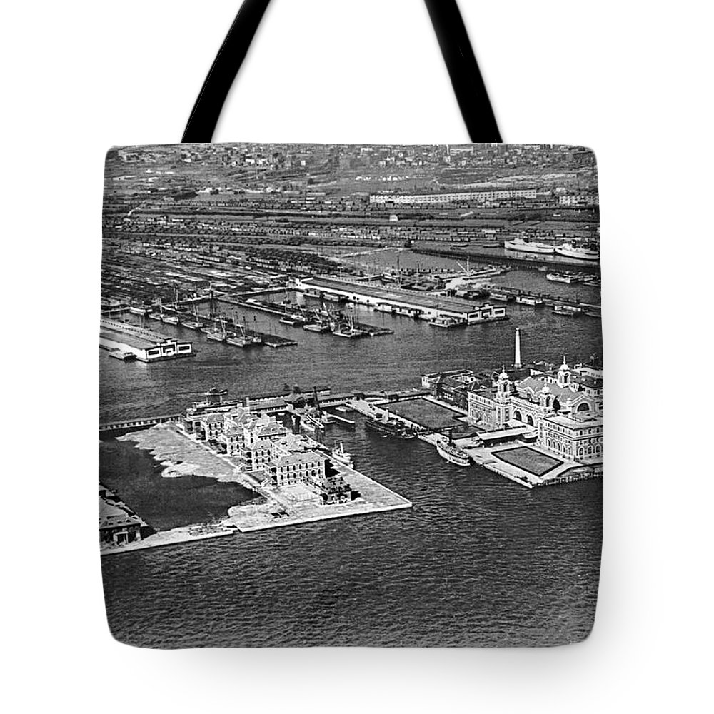 1920s Tote Bag featuring the photograph An Aerial View Of Ellis Island by Underwood Archives