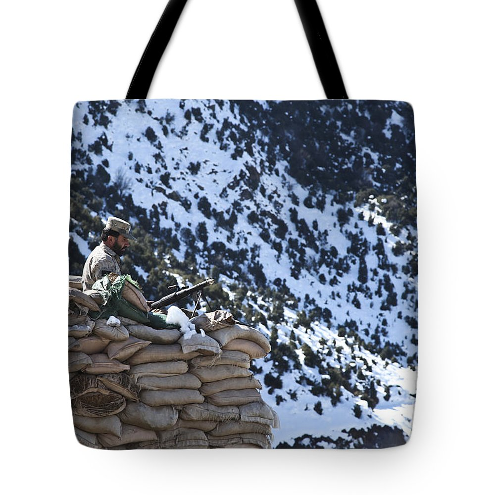 Border Patrol Tote Bag featuring the photograph An Afghan Border Patrolman Provides by Stocktrek Images