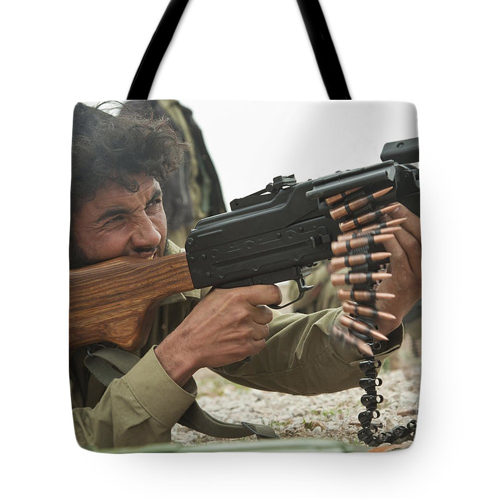 Afghanistan Tote Bag featuring the photograph An Afghan Local Police Officer Fires by Stocktrek Images