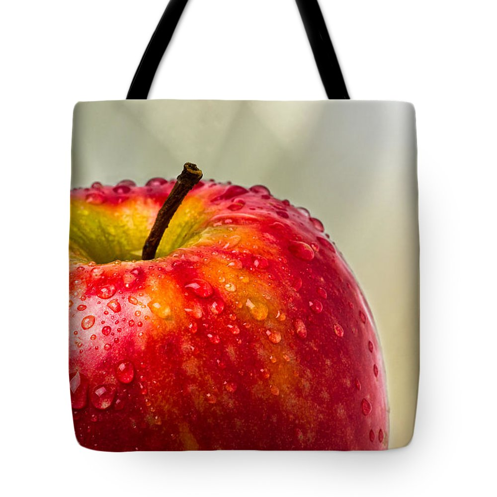 Apple Tote Bag featuring the photograph An Apple A Day by Alexander Senin