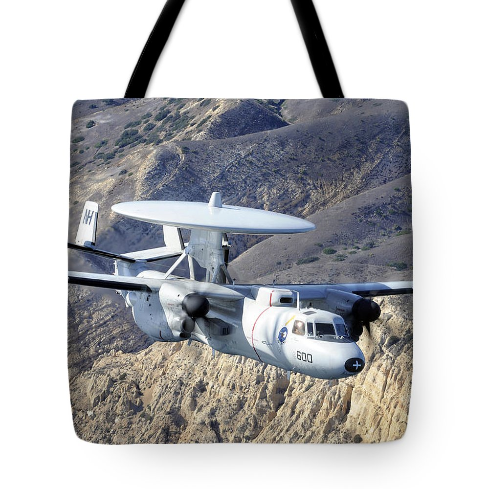 Military Tote Bag featuring the photograph An E-2c Hawkeye Aircraft Flies by Stocktrek Images