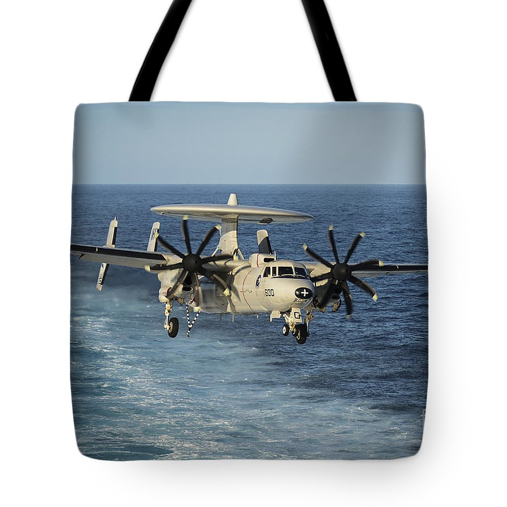 Military Tote Bag featuring the photograph An E-2c Hawkeye Prepares To Land by Stocktrek Images