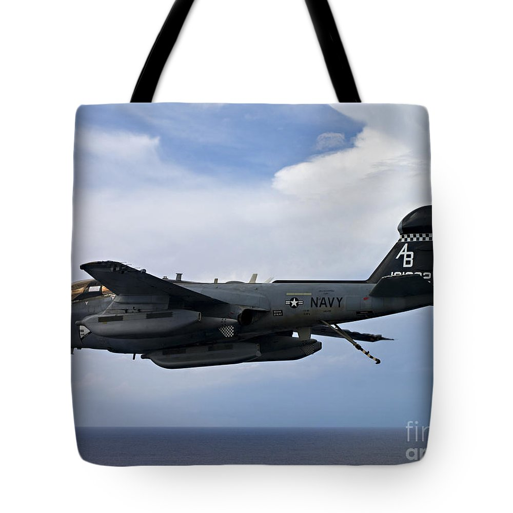 Military Tote Bag featuring the photograph An Ea-6b Prowle In Flight by Stocktrek Images