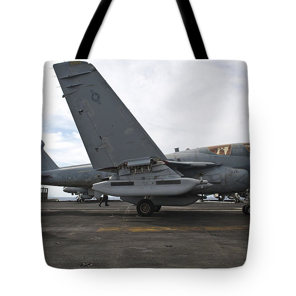 Military Tote Bag featuring the photograph An Ea-6b Prowler Prepares To Launch by Stocktrek Images