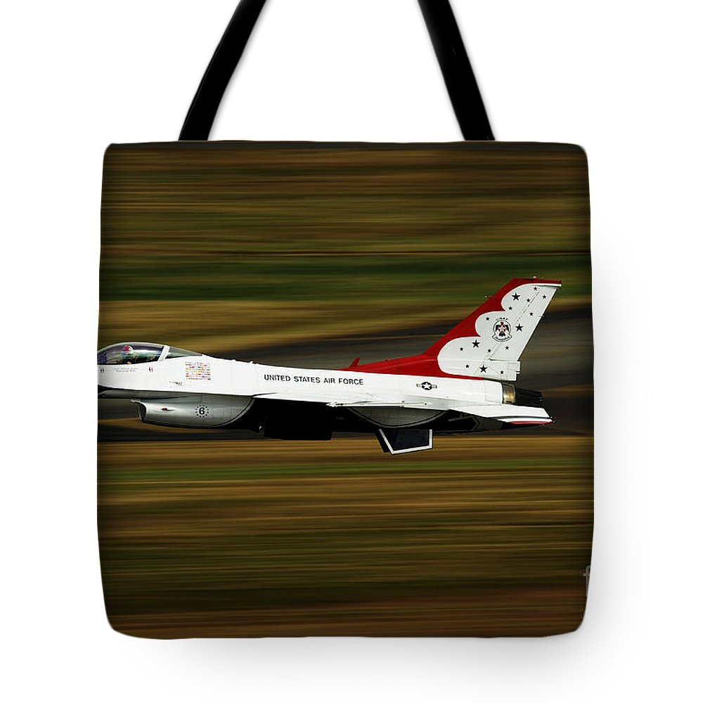 Military Tote Bag featuring the photograph An F-16 Thunderbird Of The U.s. Air by Stocktrek Images