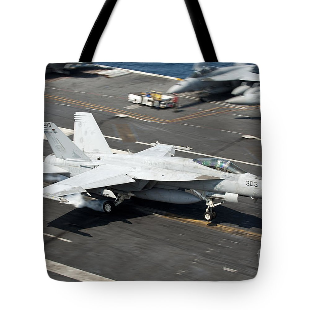 Japan Tote Bag featuring the photograph An Fa-18e Super Hornet Hooks An by Stocktrek Images