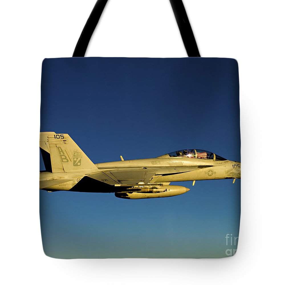 Military Tote Bag featuring the photograph An Fa-18f Super Hornet Displays by Stocktrek Images