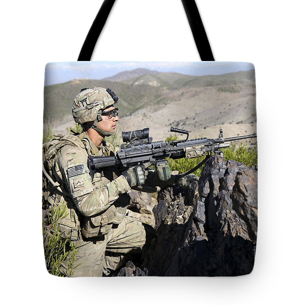 Afghanistan Tote Bag featuring the photograph An Infantryman Provides Overwatch by Stocktrek Images