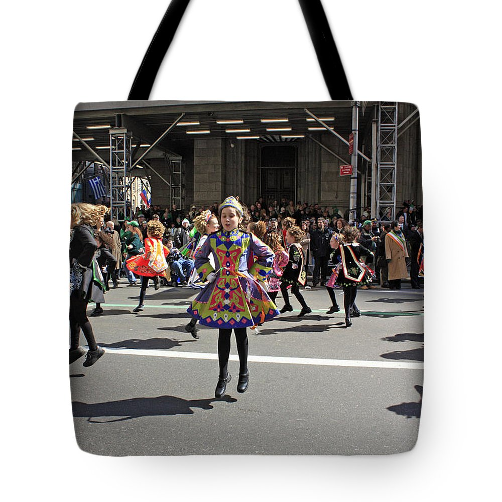Dancers Tote Bag featuring the photograph An Irish Dance Group Flying High While Dancing At The 2009 St. Patrick Day Parade by James Connor