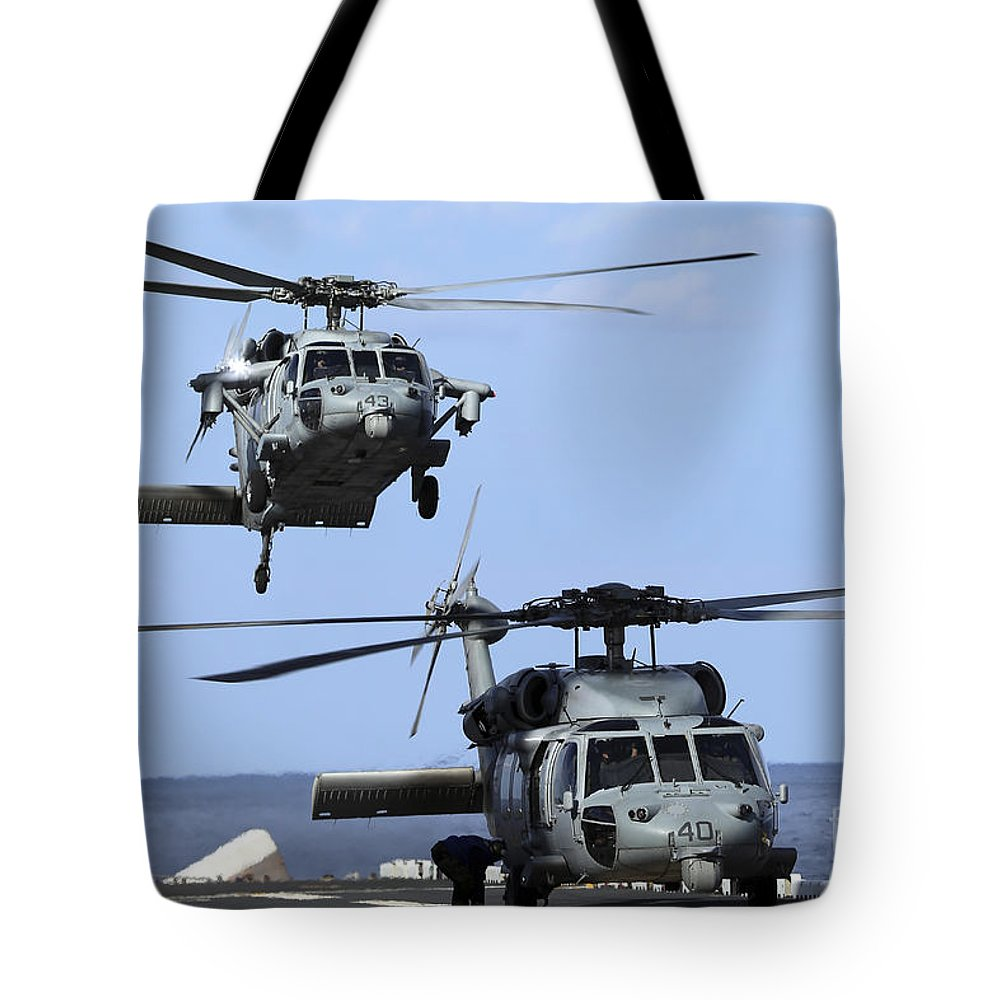 Military Tote Bag featuring the photograph An Mh-60s Sea Hawk Approaches by Stocktrek Images
