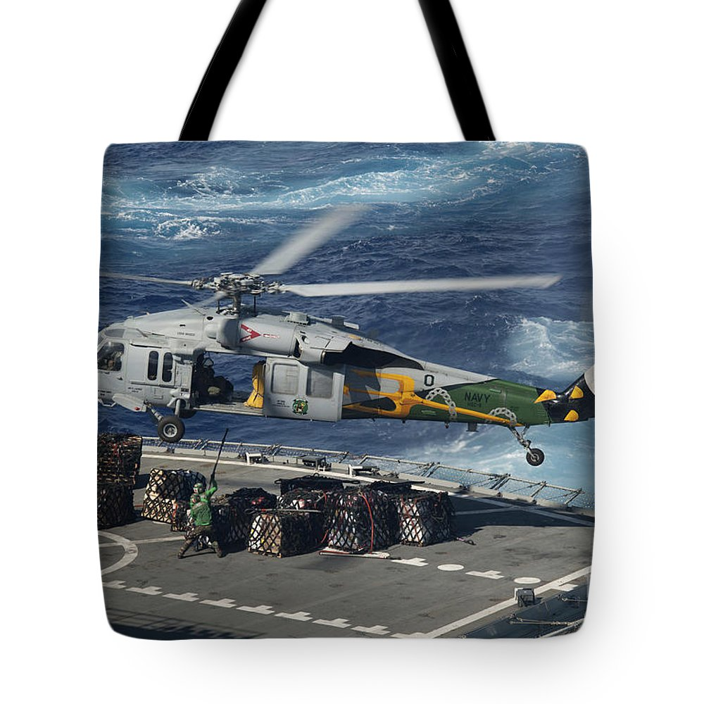 Military Tote Bag featuring the photograph An Mh-60s Sea Hawk Helicopter Picks by Stocktrek Images