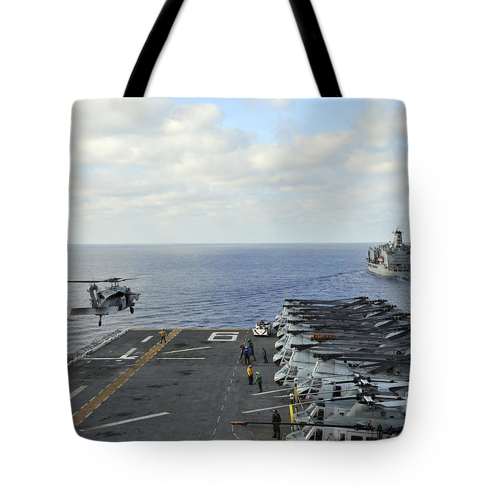 Military Tote Bag featuring the photograph An Mh-60s Sea Hawk Takes by Stocktrek Images