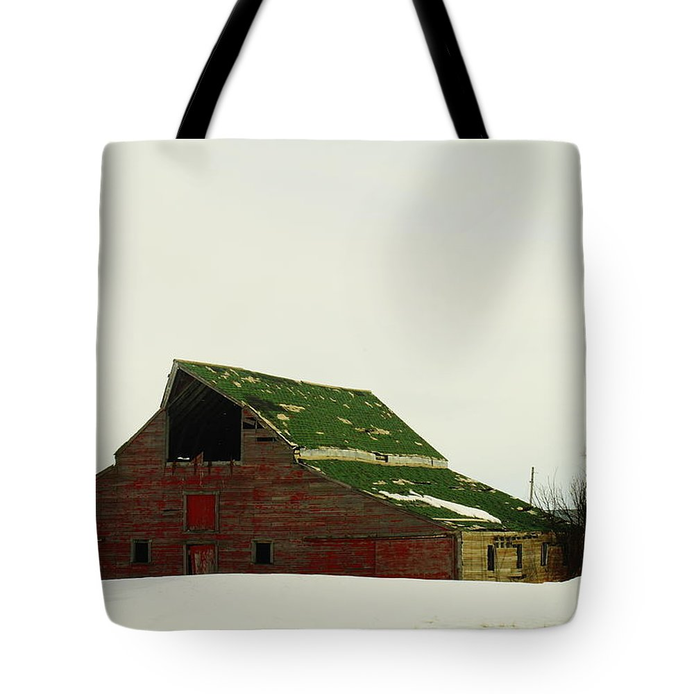 Barns Tote Bag featuring the photograph An Old Barn In Northeast Montana by Jeff Swan