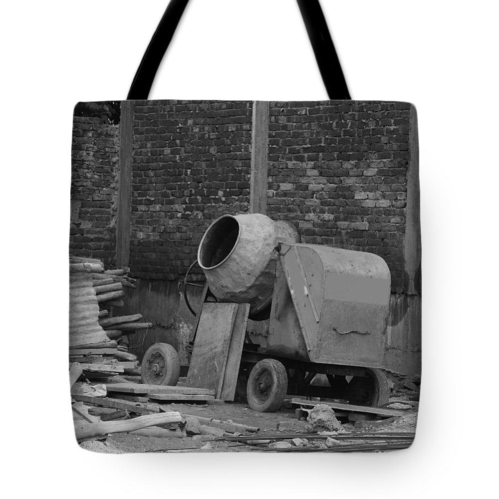 Brick Wall Tote Bag featuring the photograph An Old Cement Mixer And Construction Material by Ashish Agarwal