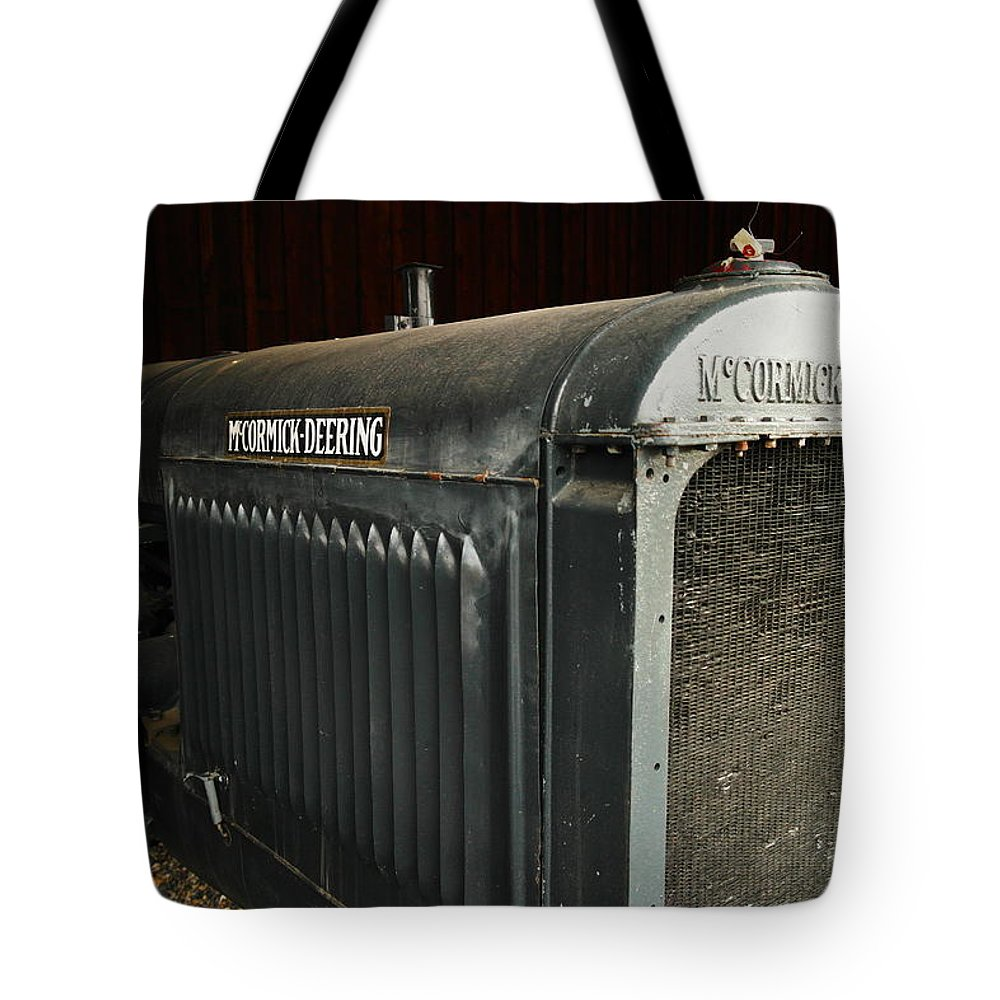 Tractors Tote Bag featuring the photograph An Old Tractor by Jeff Swan