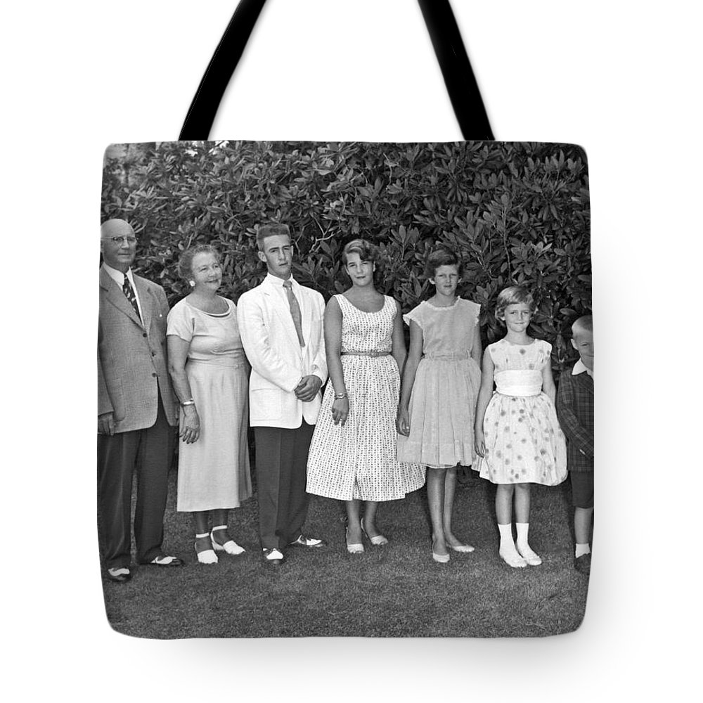 1950's Tote Bag featuring the photograph An Outdoors Family Portrait by Underwood Archives