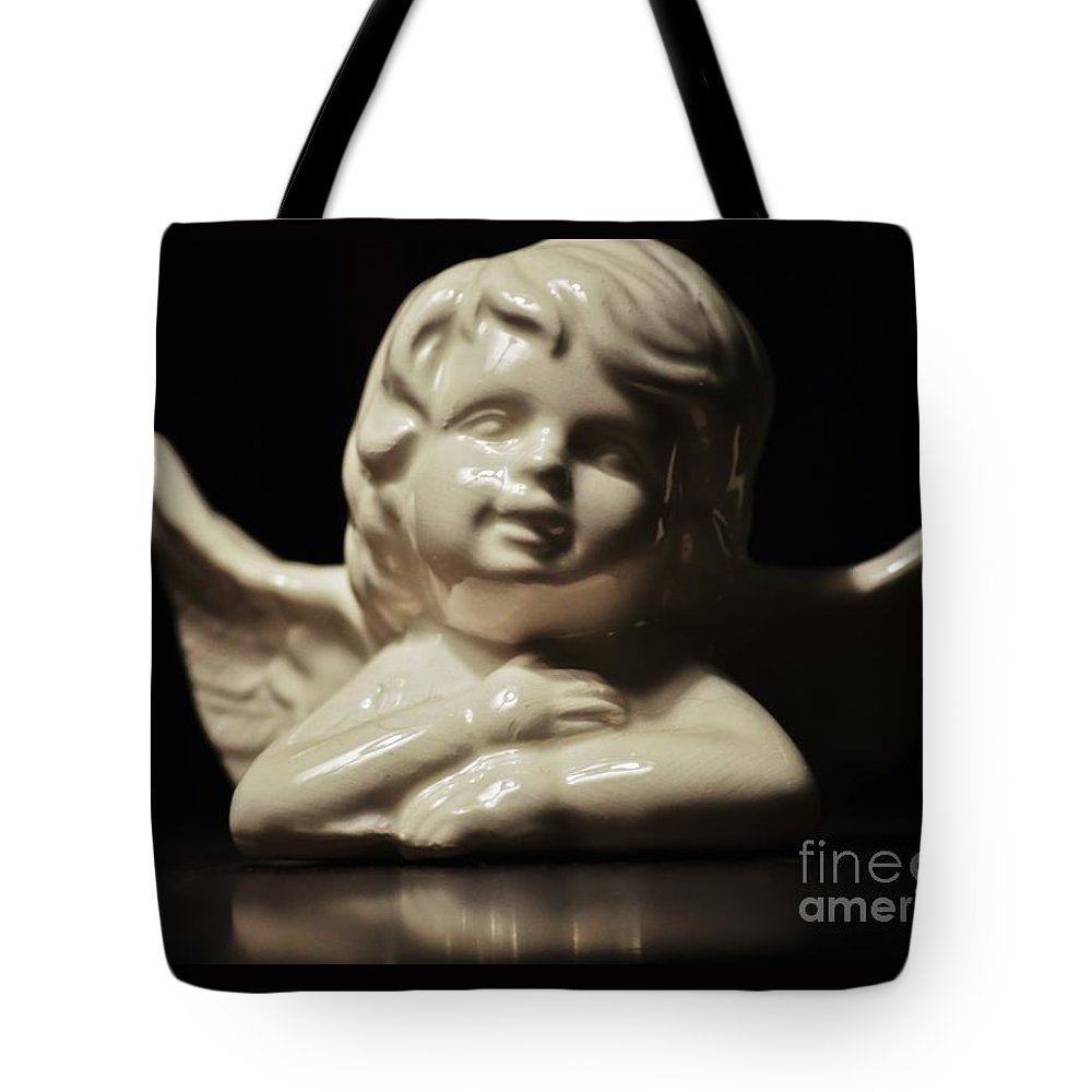 Angel Tote Bag featuring the photograph Angel On The Table by Amanda Hilden