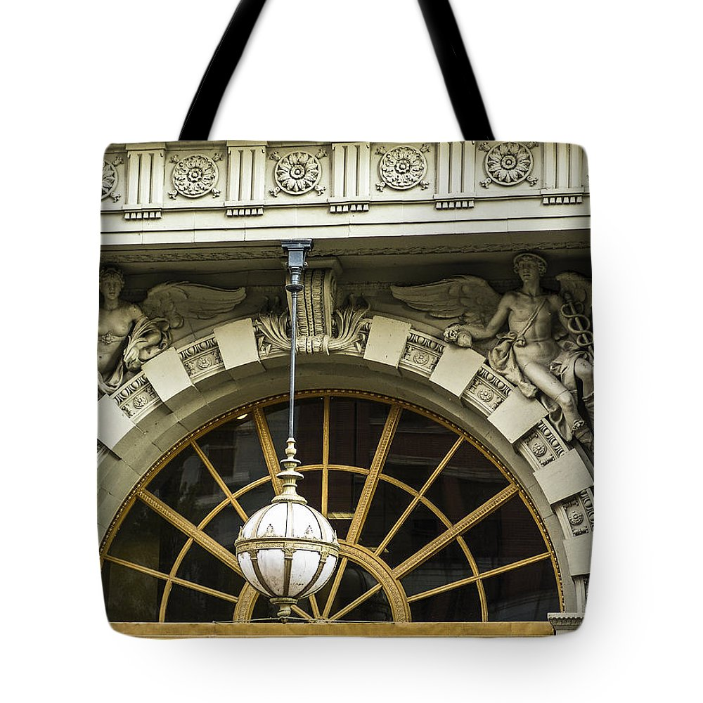 Decorative Detail Tote Bag featuring the photograph Angelic Door Topper by Eric Swan