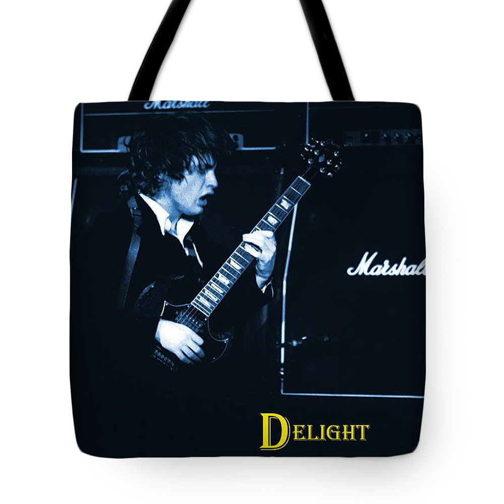 Angus Young Tote Bag featuring the photograph Angus Chords Delight Crowds In Blue by Ben Upham