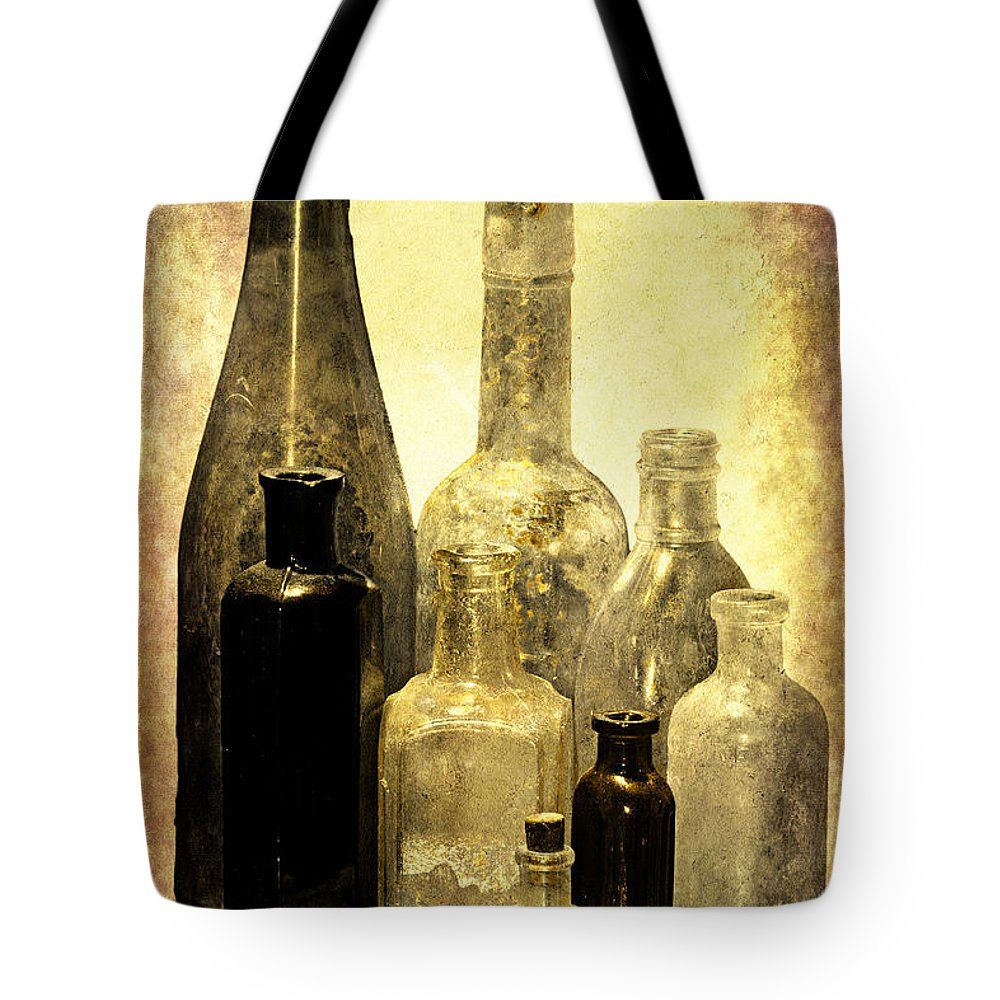 Bottles Tote Bag featuring the photograph Antique Bottles From The Past by Phyllis Denton