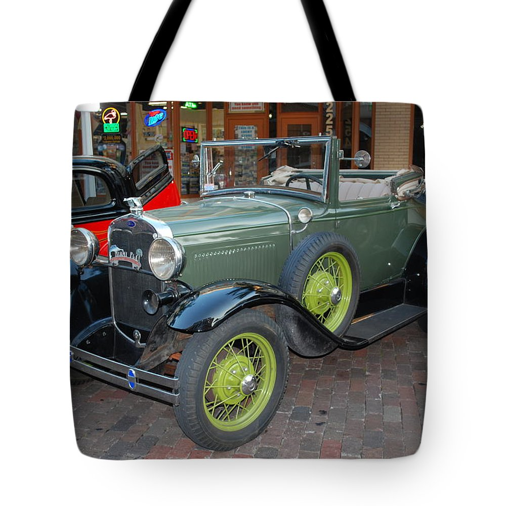 Downtown Ft.myers Tote Bag featuring the photograph Antique Convertable by Robert Floyd