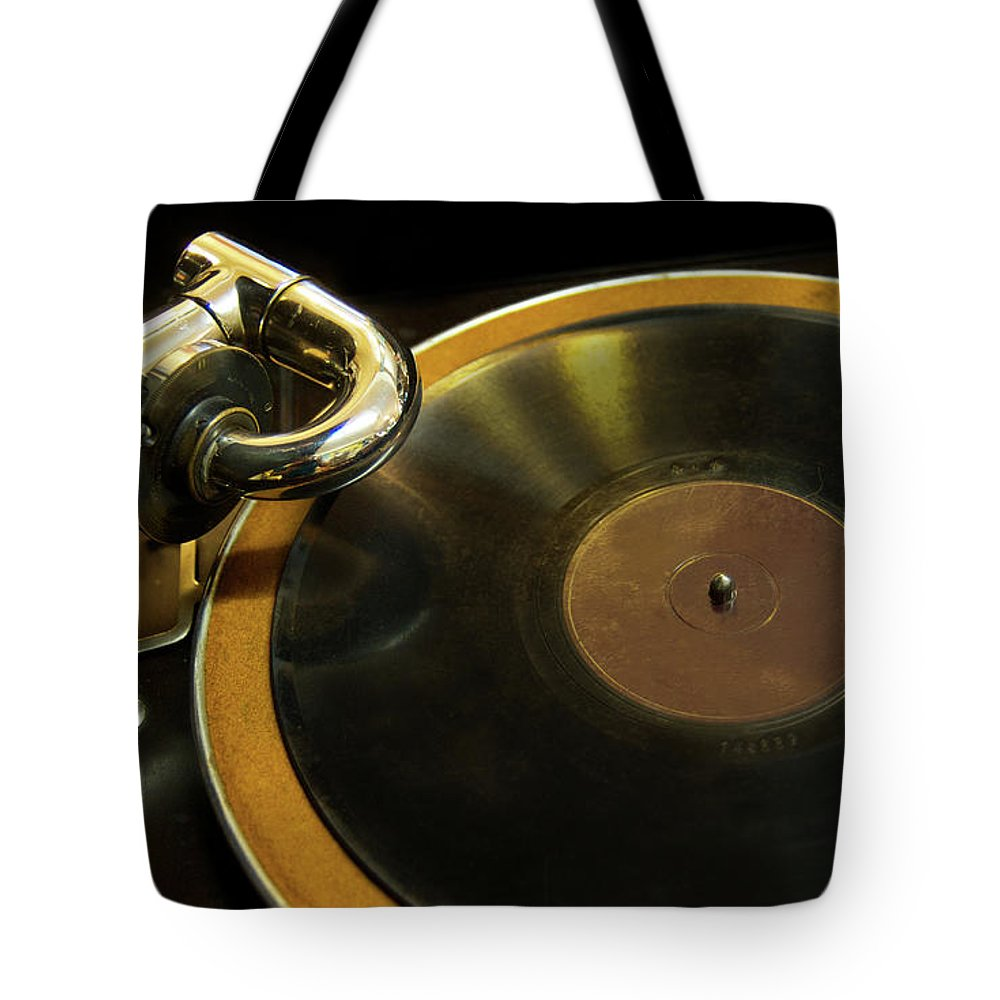 Music Tote Bag featuring the photograph Antique Phonograph With A Record by Gregory Adams