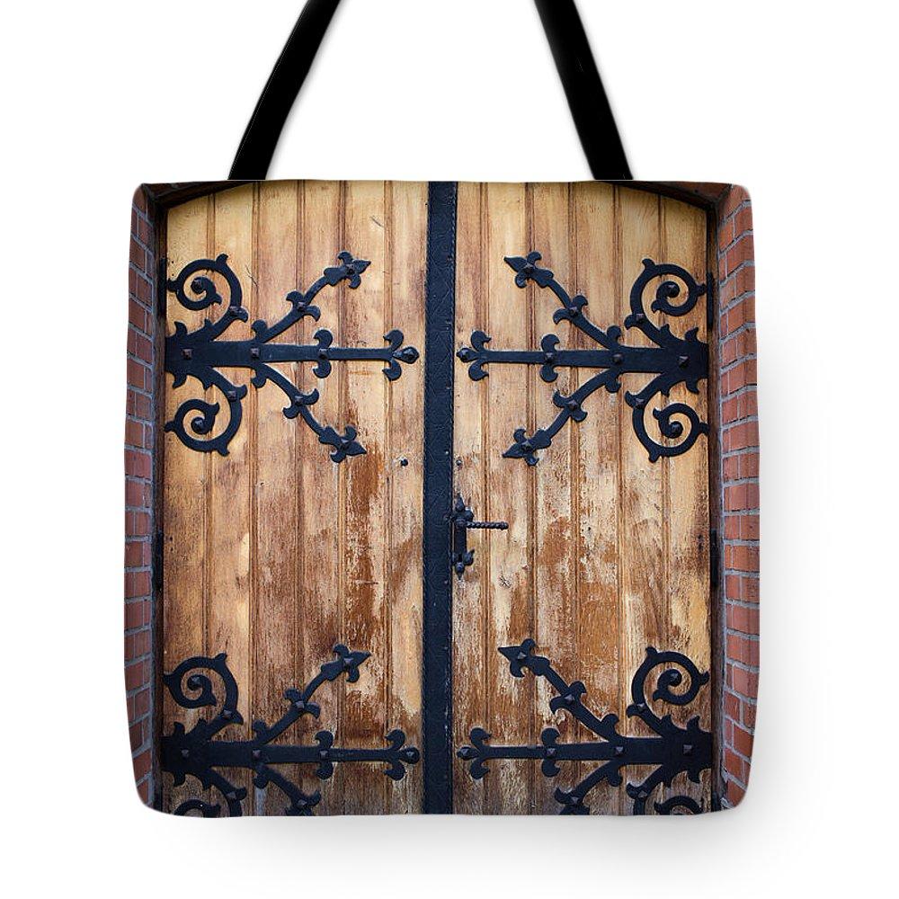 Door Tote Bag featuring the photograph Antique Wooden Door by Artur Bogacki