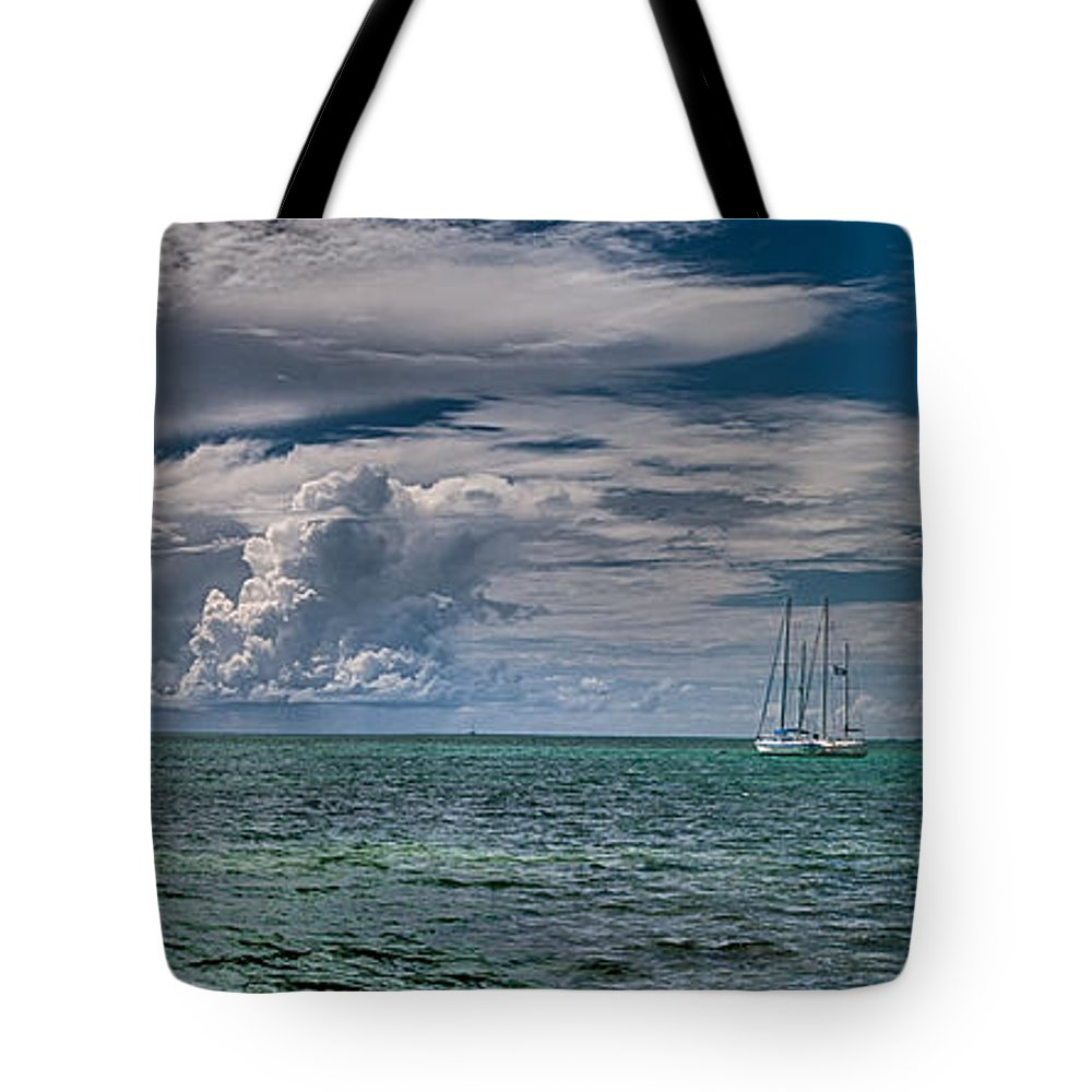 Clouds Tote Bag featuring the photograph Approaching Storm At Whale Harbor by Robert Swinson