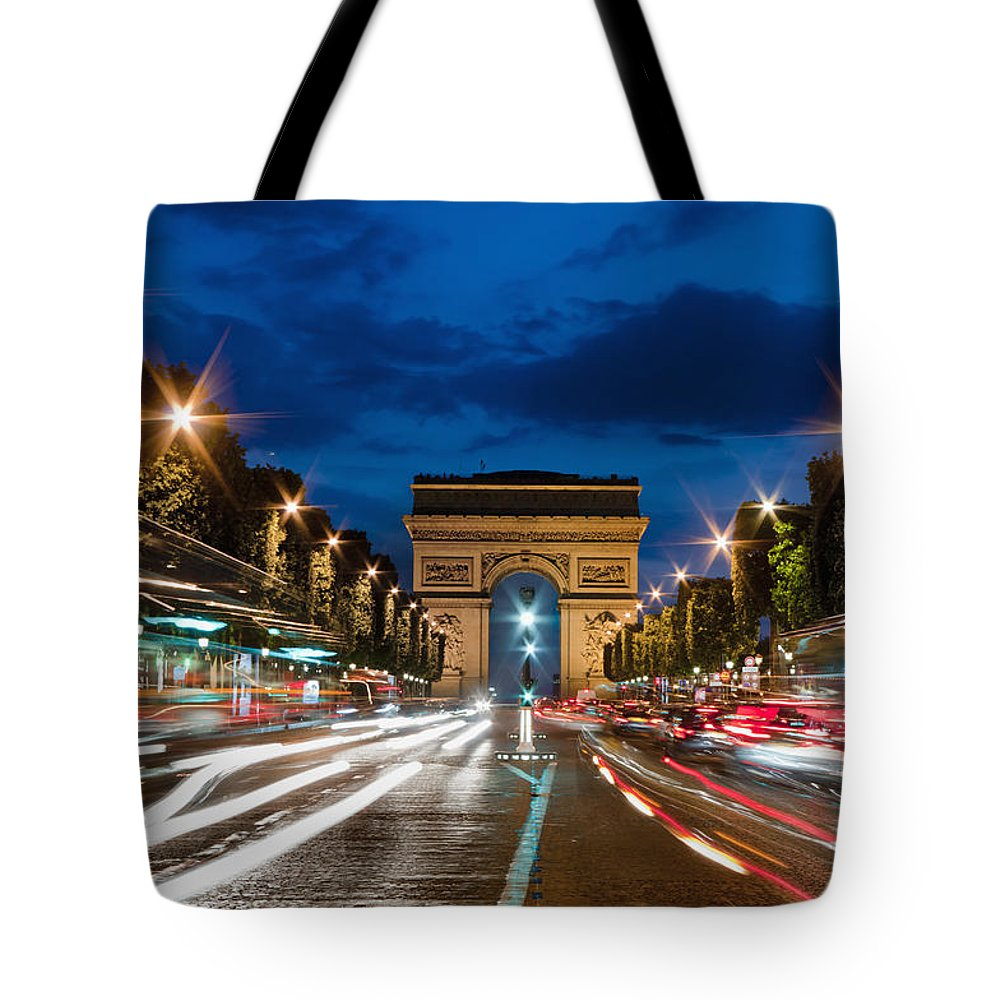 Outdoors Tote Bag featuring the photograph Arc De Triomphe At Dusk Paris by Charles Bowman