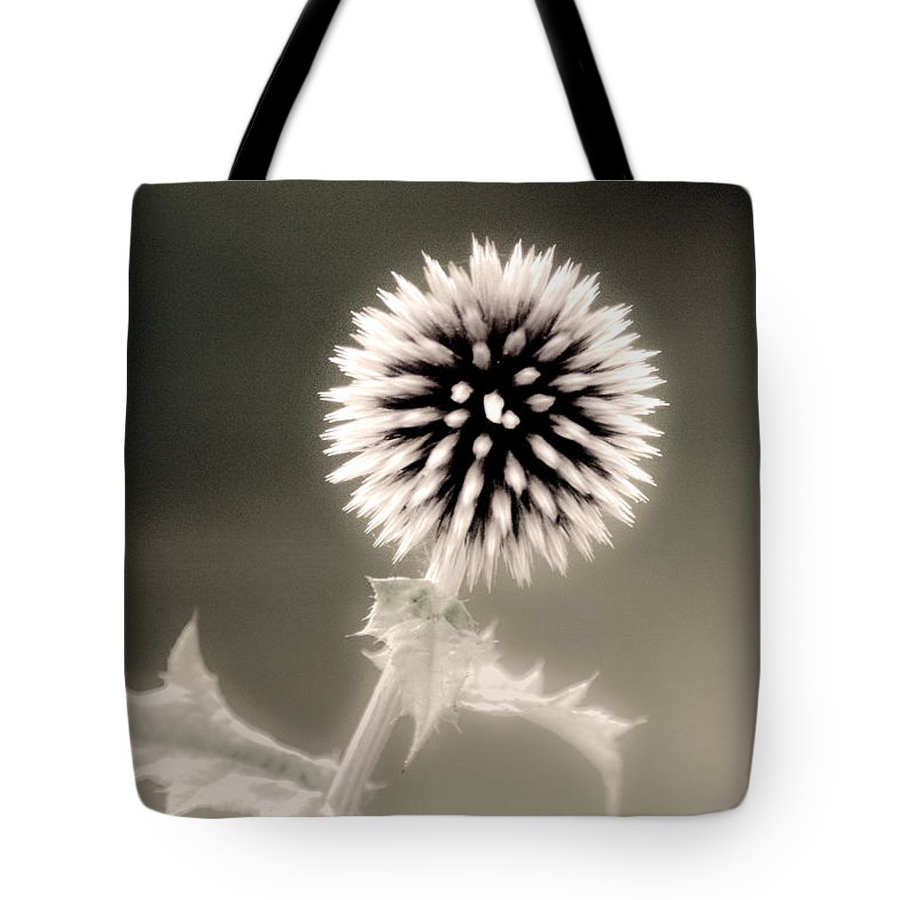 Black And White Tote Bag featuring the photograph Artistic Black And White Flower by Don Johnson