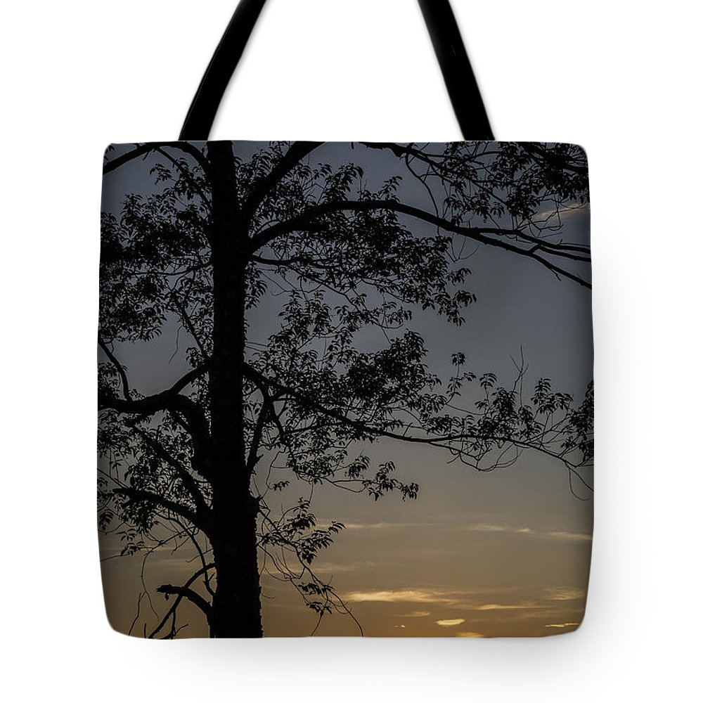 Sunset Tote Bag featuring the photograph As The Sun Fades Behind The Mountian by Karol Livote
