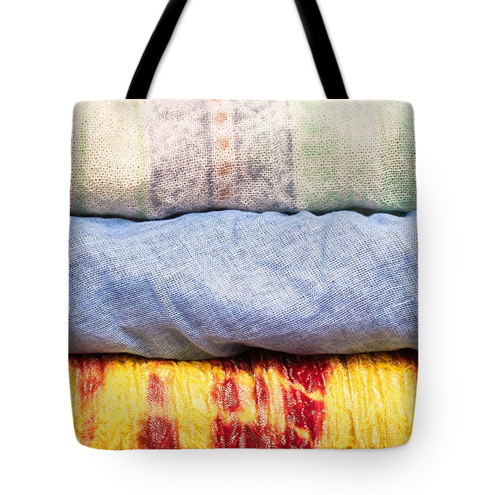 Africa Tote Bag featuring the photograph Asian Cloths by Tom Gowanlock