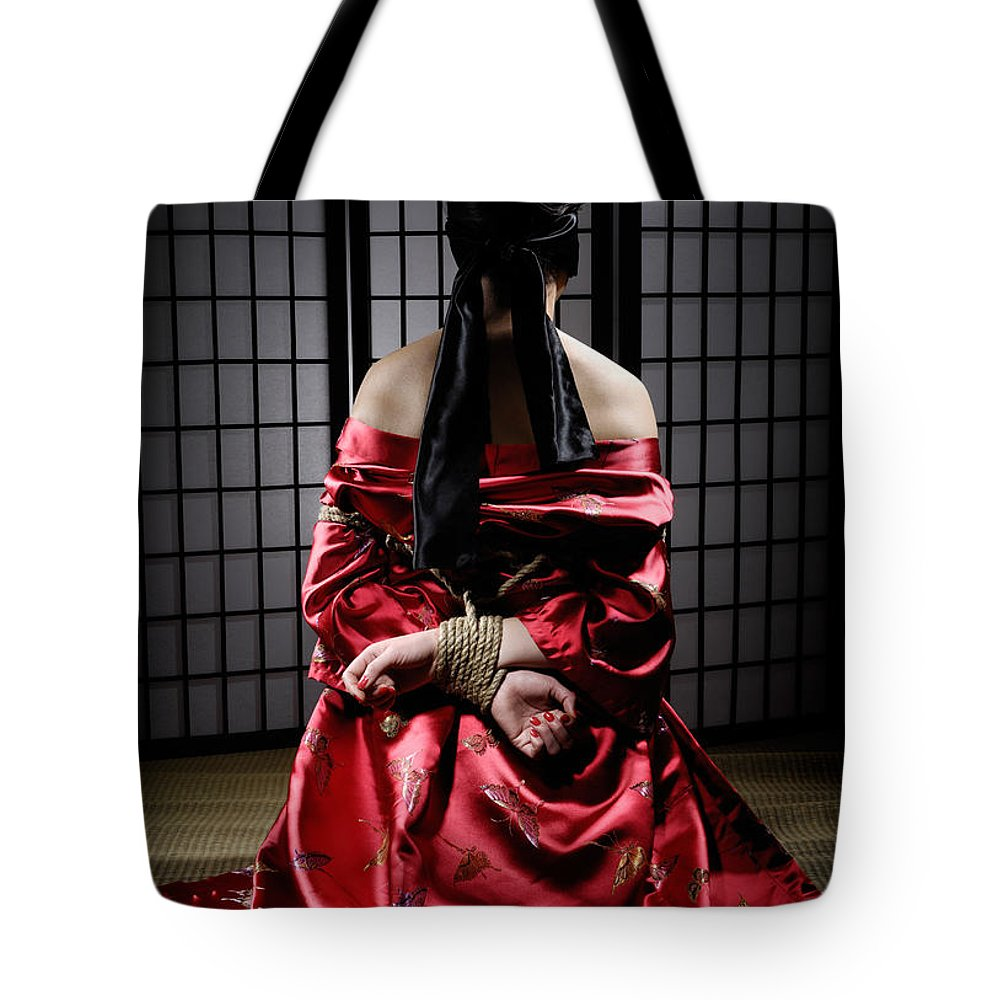 Bondage Tote Bag featuring the photograph Asian Woman With Her Hands Tied Behind Her Back by Oleksiy Maksymenko