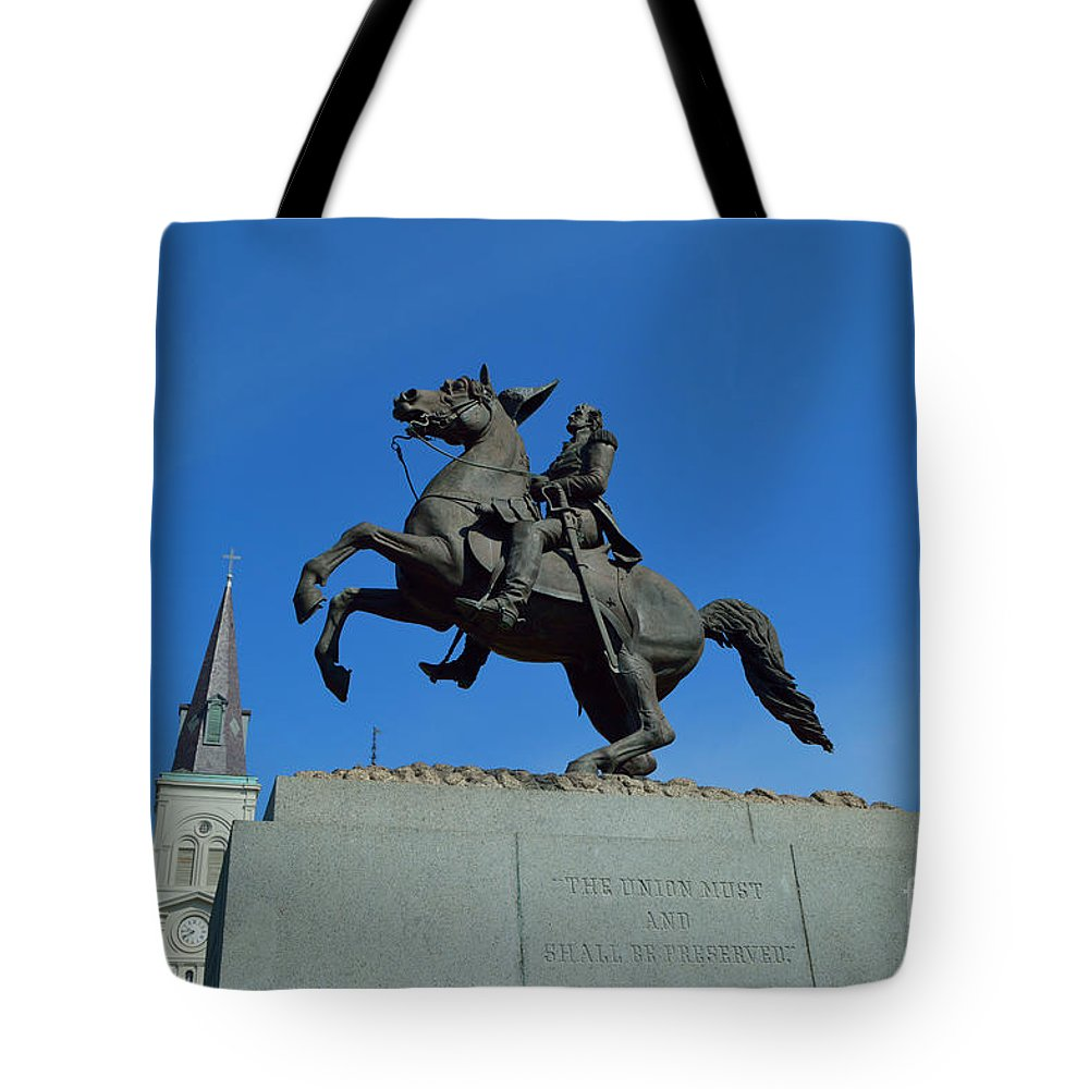 St. Louis Cathedral Tote Bag featuring the photograph At The Feet Of A Hero by Alys Caviness-Gober