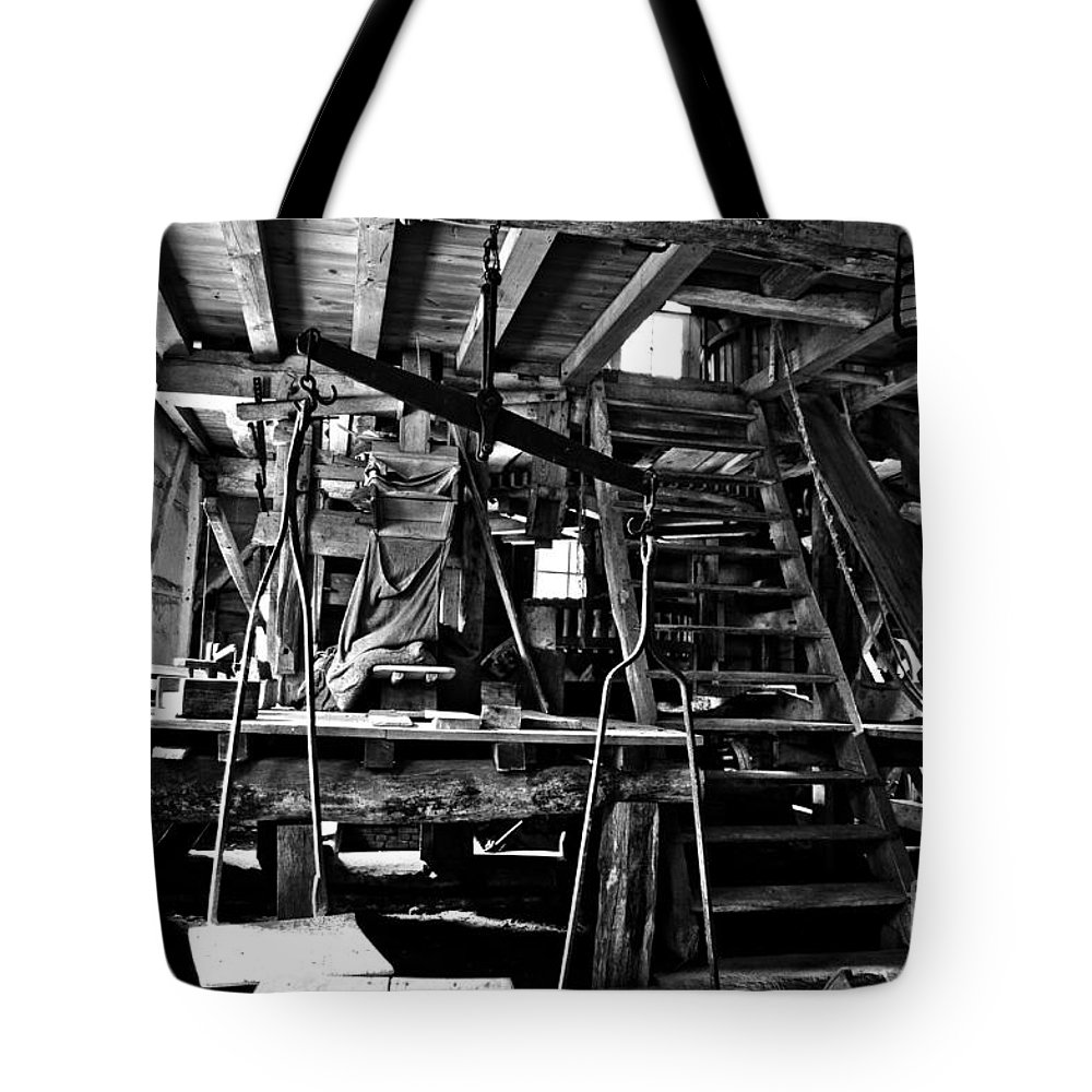 Mill Tote Bag featuring the photograph At The Grinder by Brothers Beerens