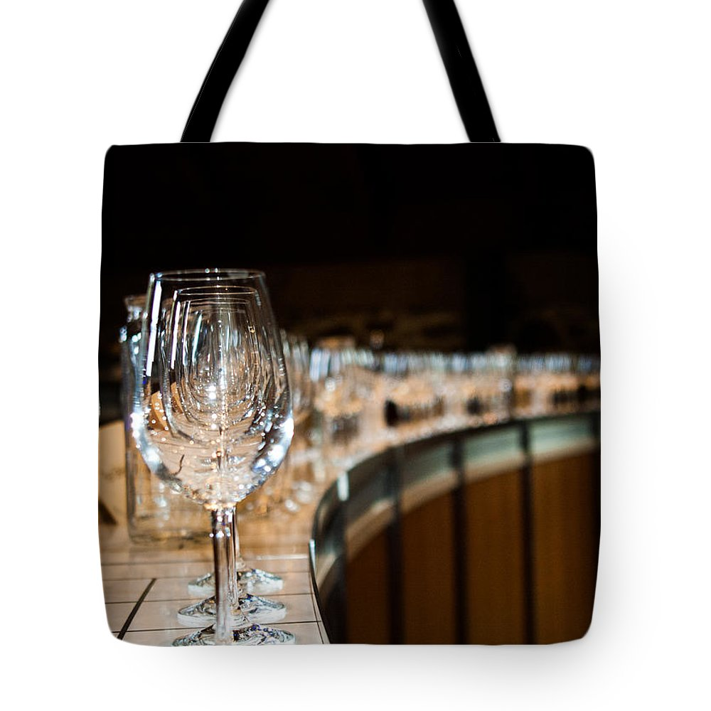 Glass Tote Bag featuring the photograph At The Ready by Alex Lapidus