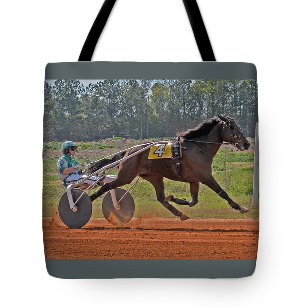 Harness Racing Tote Bag featuring the photograph At The Three Quarter Mile Post by Donna Brown