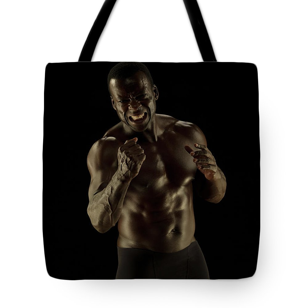 Toughness Tote Bag featuring the photograph Athletic Female, Angry Shout, Clenched by Jonathan Knowles