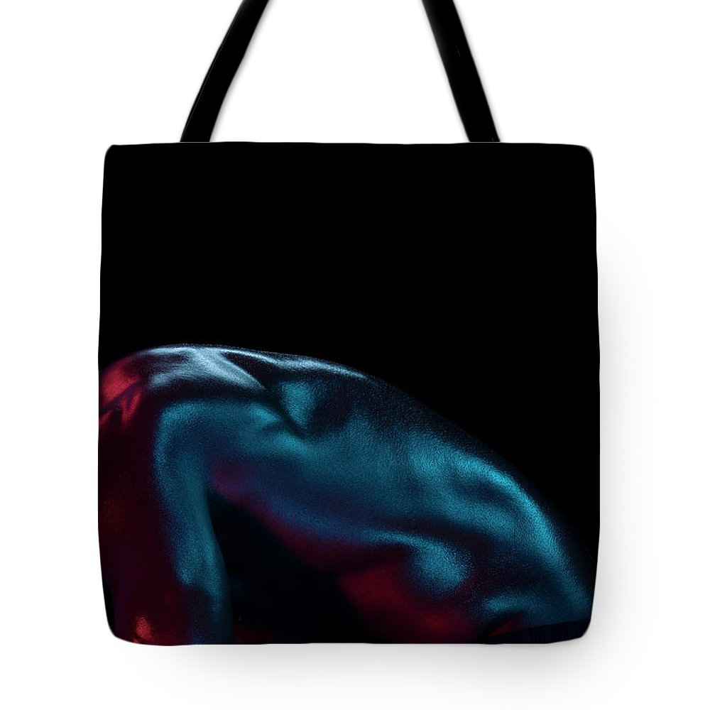Cool Attitude Tote Bag featuring the photograph Athletic Male Bending, Head Down, Side by Jonathan Knowles