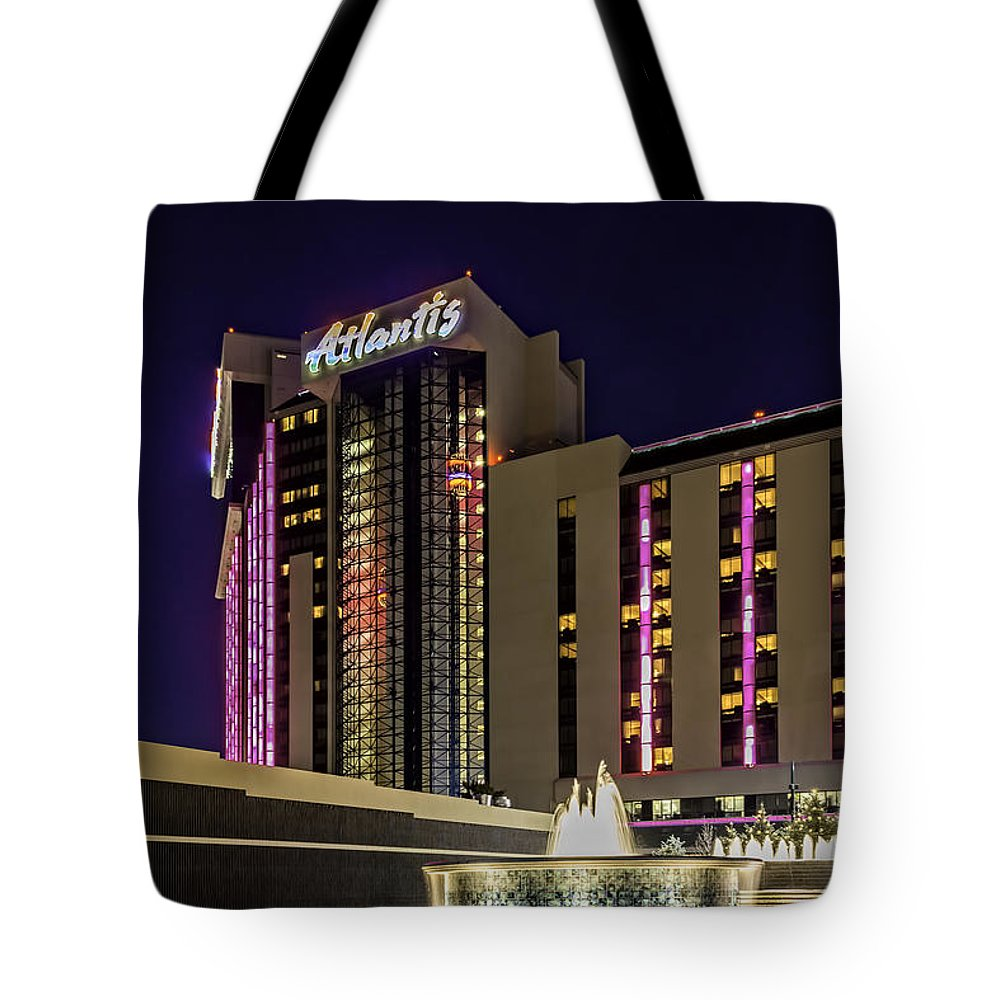 Architecture Tote Bag featuring the photograph Casino Tower by Maria Coulson