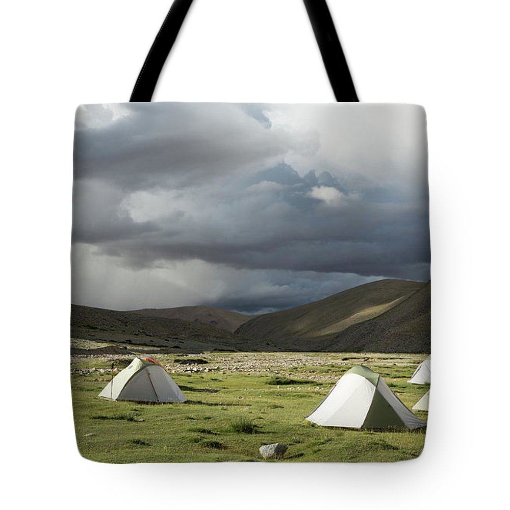 Tranquility Tote Bag featuring the photograph Atmospheric Grassy Camping by Jamie Mcguinness - Project Himalaya